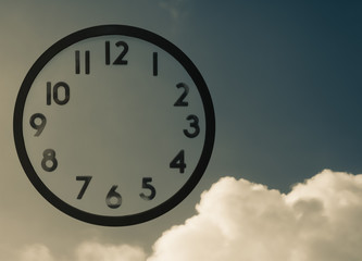 Clock with no hands   on blue vintage  sky