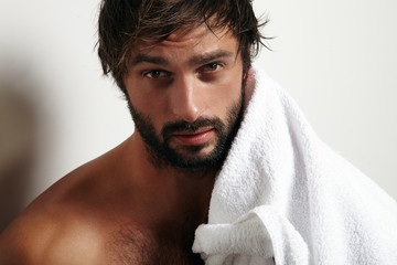 portrait of a man with a towel