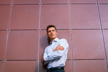 Young business man in a bright shirt