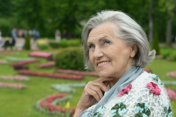 Senior woman on walk in summer park