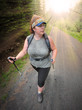 Overweight woman walking in nature. Weight loss concept.