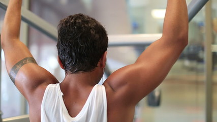 attractive young man exercising in the gym