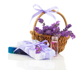 Natural handmade lavender soap and oil with fresh lavender on wh