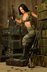 Sexy brunette woman with gun