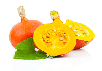 yellow pumpkins vegetables with green leaves isolated on white