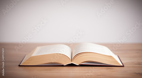 Open book on wooden deck - 69531651