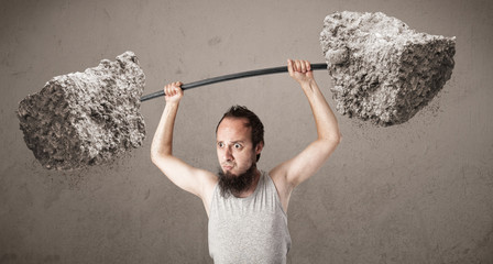 skinny guy lifting large rock stone weights