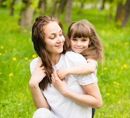 happy family - daughter, and mother in park