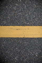 Asphalt road with marking lines. Close-up background texture