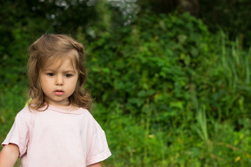 thoughtful little girl  green background