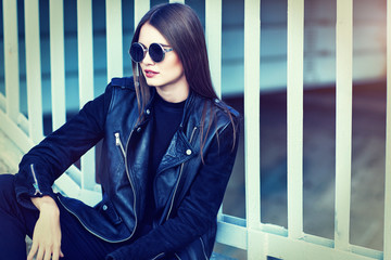 fashion model in sunglasses posing outdoor