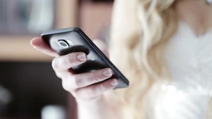 Bride with a smartphone