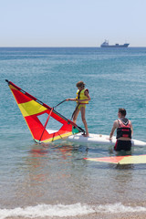 Little girl learning windsurfing