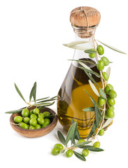 olives and olive oil in a bottle