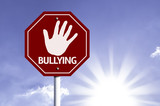 Stop Bullying red sign with sun background poster