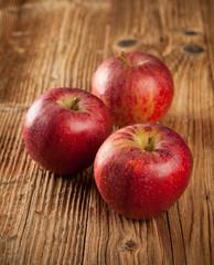 Fresh harvested apples on wood