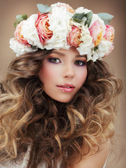 Woman in Wreath of Flowers with Perfect Skin and Frizzy Hair