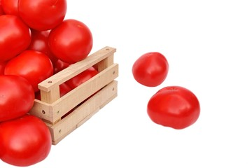 Many tomatoes in wooden box