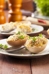 Baked eggs, stuffed with ham and parsley
