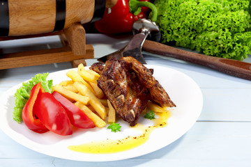 Grilled ribs on plate
