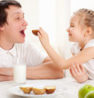 Child with father have a breakfast