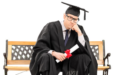 Angry college graduate holding a diploma