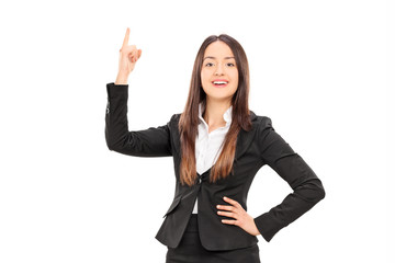 Businesswoman holding her finger up