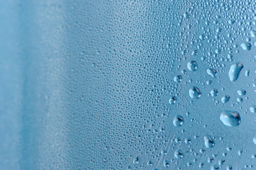 Close-Up of Water Drops on Blue Background