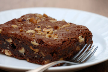 Brownie with Hazelnuts in Plate