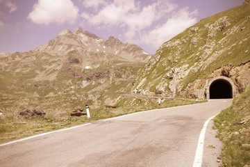 Alps in Italy - Gavia Pass Road. Cross processed color tone.