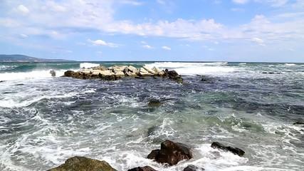 Breaking big waves at rocky seashore