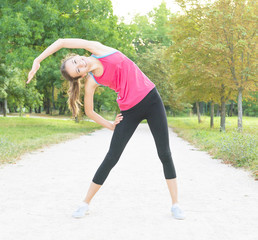 girl doing exercises on the track in the park