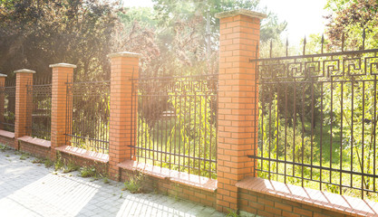 fence of red brick in the early morning