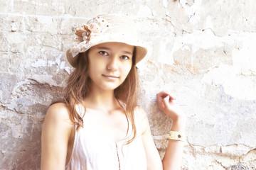 Smiling girl in hat sepia