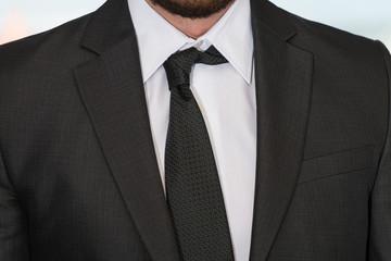 Close Up Of Businessman Adjusting Tie
