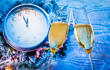 New Year or Christmas at midnight with champagne flutes