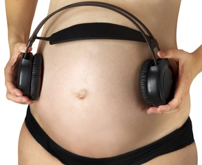 Pregnancy belly baby headphones music sound white background