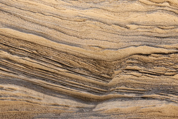 texture of golden lines of loose rock