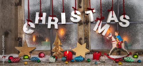 Leinwandbild Motiv Weihnachtsfenster in bunten Farben als Weihnachtskarte