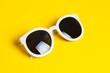 Leinwanddruck Bild - Stylish white sunglasses