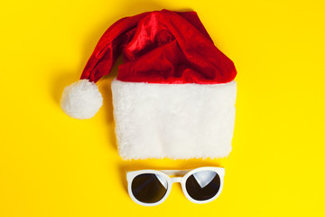 Stylish white sunglasses with red hat santa claus