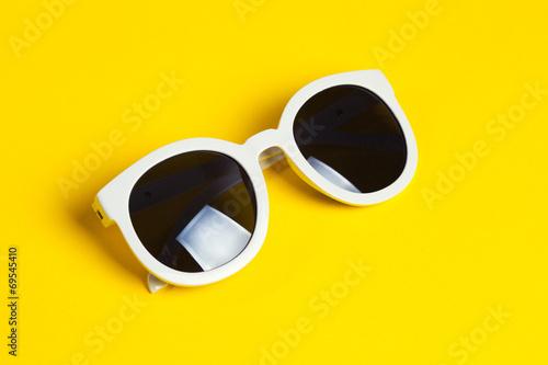 Leinwanddruck Bild Stylish white sunglasses