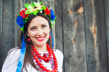 beautiful young woman wearing national ukrainian clothes sitting