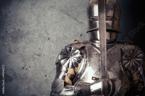 knight wearing armor and holding two-handed sword Poster