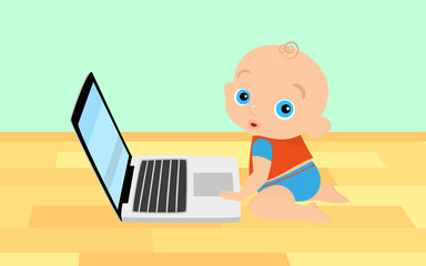 Little boy is playing with laptop