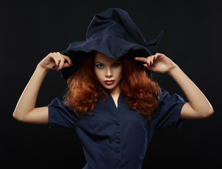 beautiful red-haired girl in a  costume witch