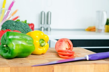 Fresh vegetables on a chopping board in the kitchen