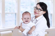 Asian businesswoman and her baby 3