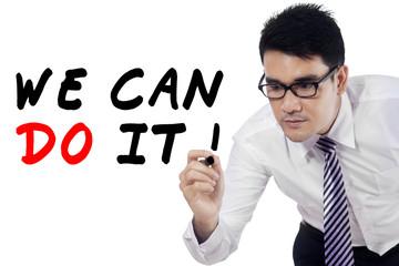 Businessman writes motivation words 2