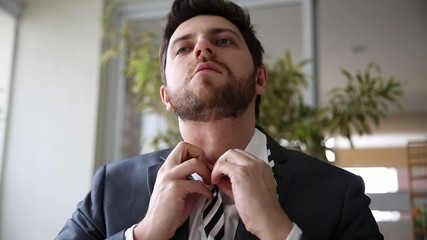 Exhausted Business Man taking off the tie at home